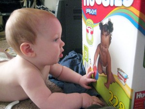 Baby staring at Huggies baby